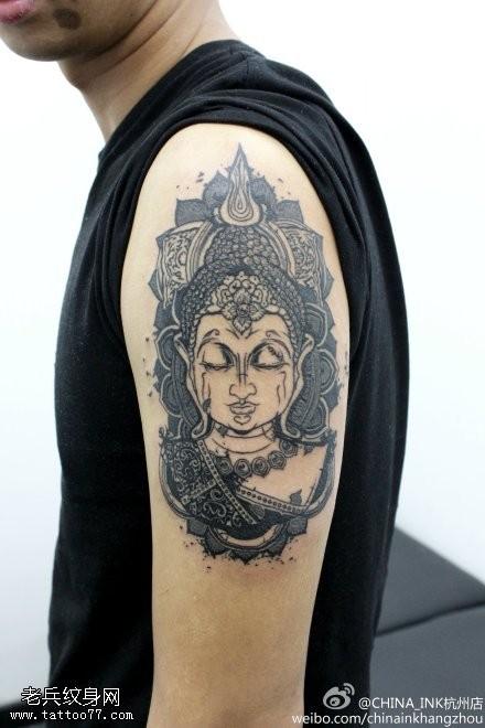 一款手臂佛头纹身图案