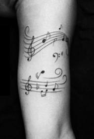男生手臂上黑色线条文艺小清新唯美音符纹身图片