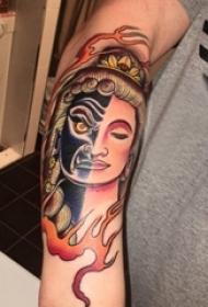 纹身佛像图男生手臂上火焰和佛像纹身图片