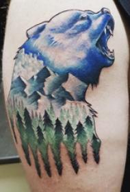 大臂纹身图 男生大臂上森林风景和熊纹身图片