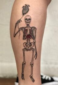 欧美小腿纹身 女生小腿上心脏和骷髅纹身图片