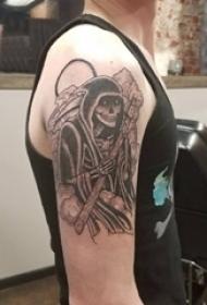 死神紋身 男生大臂上黑色的骷髏死神紋身圖片