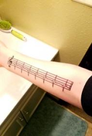 簡單線條紋身 女生手臂上音符和心電圖紋身圖片