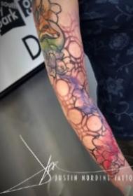 好看的一组9张彩色水墨纹身作品图案