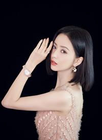 佟麗婭裸色長裙清新淡雅寫真圖片