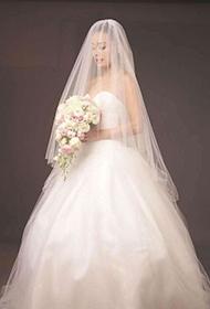 香港女明星容祖兒披婚紗展現純美小女人