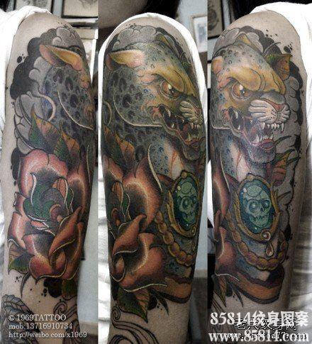 手臂时尚很酷的一款豹头纹身图案