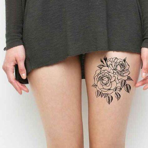 优雅的黑色花蕊大腿纹身图案