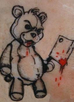 邪惡的泰迪熊和刀紋身圖案