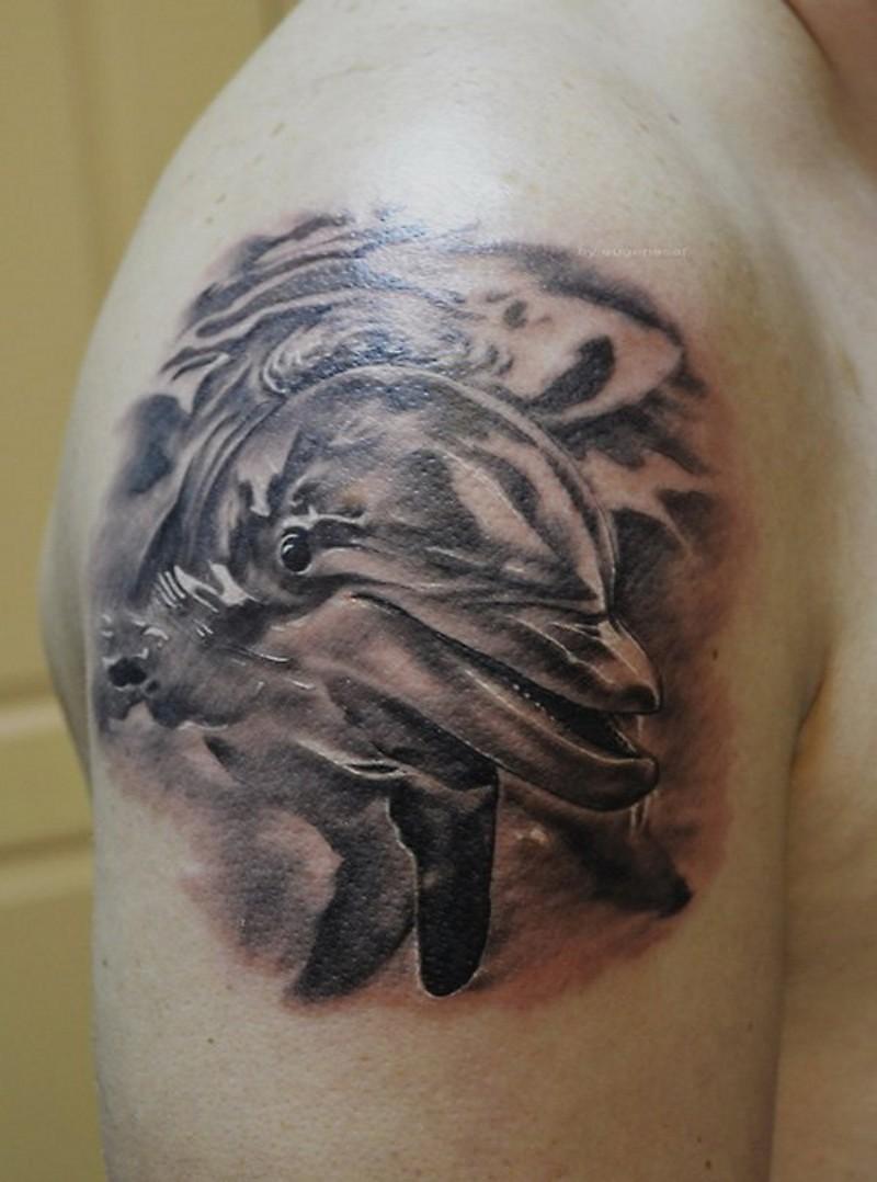 肩部非常精美的黑白海豚纹身图案