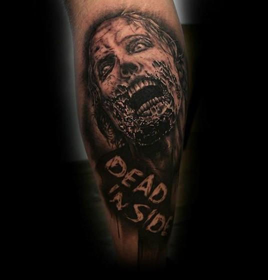 小腿黑灰恐怖的僵尸脸纹身图案
